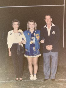 Holly Davis at homecoming game with her parents at Crystal River High School, fall 1984.