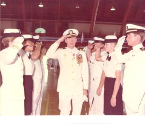 Retirement picture of Holly Davis' father Tom, with her brother and sister, both also Naval officers, taking part in the ceremony.