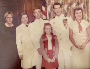 Holly Davis at age 11 with her parents and siblings (two are Naval officers) at her father's retirement ceremony.