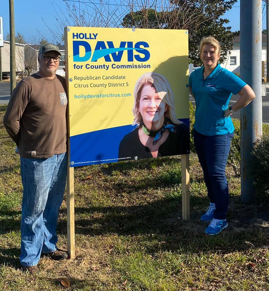 Joe Bell & Holly Davis installing a campaign sign